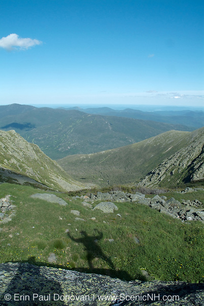 Looking into Tuckerman Ravine from the trail junction of  Tuckerman Ravine and Lawn Cutoff Trail during the summer months in the scenic landscape of the White Mountains, New Hampshire USA ..Notes:  A hikers shadow can be seen in the foreground