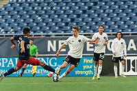 FOXBOROUGH, UNITED STATES - MAY 28: Harvey Neville #6 of Fort Lauderdale CF brings the ball forward as Damian Rivera #72 of New England Revolution II defends during a game between Fort Lauderdale CF and New England Revolution II at Gillette Stadium on May 28, 2021 in Foxborough, Massachusetts.