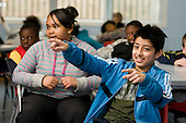8-11 year-olds take part in a game of Family Fortunes, during an Edutain programme at Avenues Youth Club organised by Westminster Sports Unit.