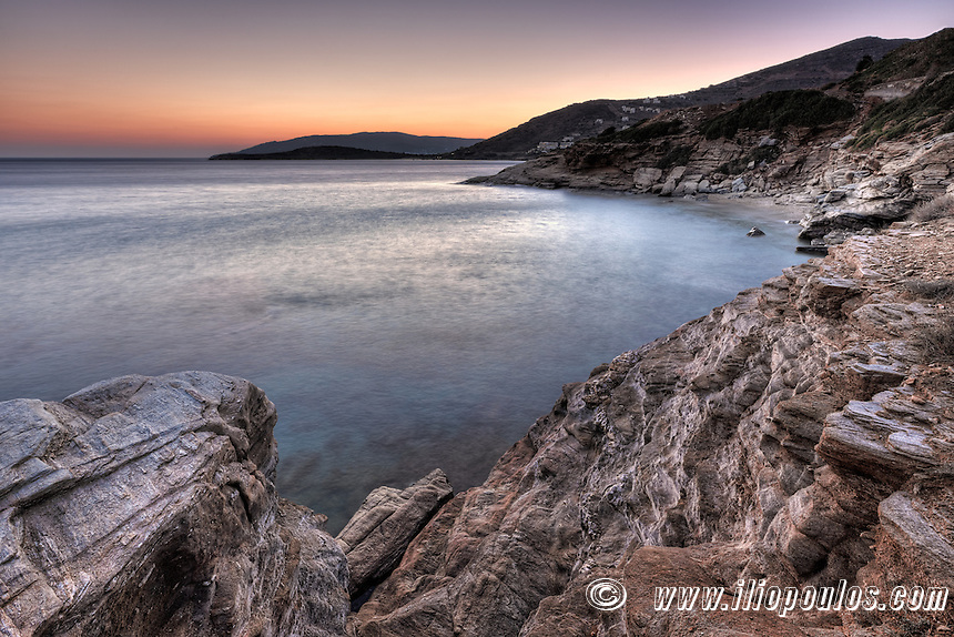 The sunset at Agios Kyprianos in Andros, Greece