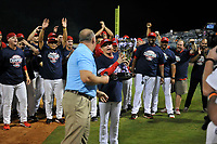 Greenville Drive players celebrate their 2017 South Atlantic League Championship as league President Eric Krupa presents the trophy to manager Darren Fenster following an 8-3 win over the Kannapolis Intimidators in Game 4 of the Championship Series on Friday, September 15, 2017, at Fluor Field at the West End in Greenville, South Carolina. It was Greenville's first SAL Championship. Greenville won the series 3-1. (Tom Priddy/Four Seam Images)