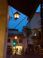 November, 2003, Twilight with city lights amidst downtown buildings wof the Mission architecture style in Santa Barbara, California
