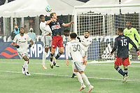 FOXBOROUGH, MA - NOVEMBER 1: Ola Kamara #9 of DC United and Henry Kessler #4 of New England Revolution compete for a high ball during a game between D.C. United and New England Revolution at Gillette Stadium on November 1, 2020 in Foxborough, Massachusetts.