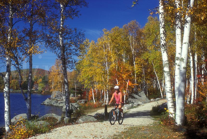 biking, woman, fall, Groton State Forest, VT, Vermont, Woman biking along Boulder Beach on Lake Groton in Groton State Forest in the autumn.