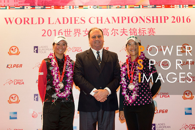 Kuo Ai-Chen of Chinese Taipei (left) and  Lin Tzu-Chi of Chinese Taipei (right) receive the medal for third team from the hands of Iain Roberts (center) during the Prize giving ceremony of the World Ladies Championship 2016 on 13 March 2016 at Mission Hills Olazabal Golf Course in Dongguan, China. Photo by Victor Fraile / Power Sport Images