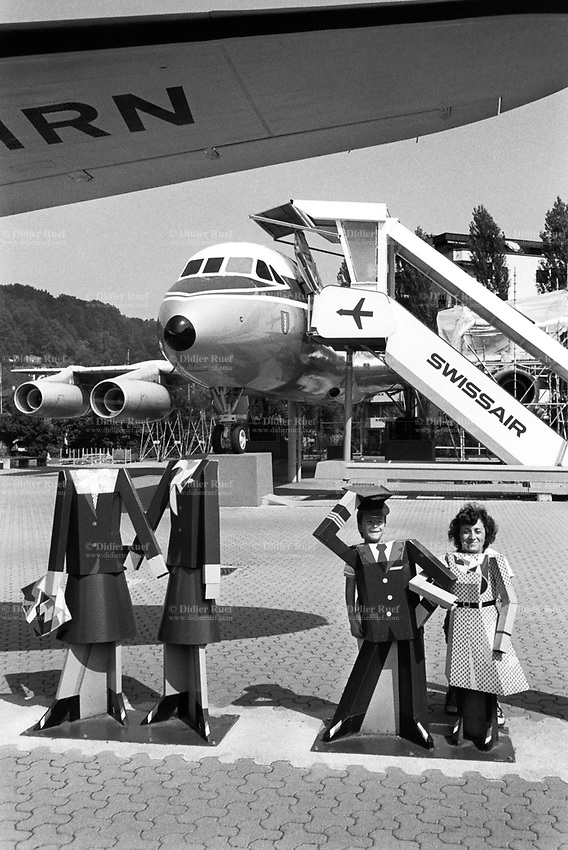Switzerland. Luzern. Swissair planes at the Swiss Museum of Transport (Verkehrshaus der Schweiz). A mother and her son posed as crew members. Swissair was the former national airline of Switzerland. For most of its 71 years, Swissair was one of the major international airlines and was regarded as a Swiss national symbol and icon. The airline was declared bankrupt on March 31 2002. © 1990 Didier Ruef