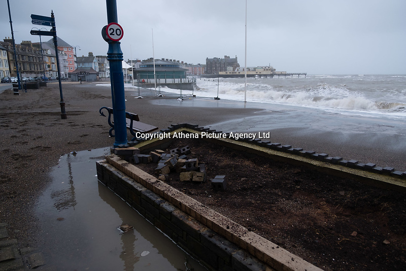 On the day after Storm Eleanor swept a trail of damage across the UK, strong westerly winds gusting over 75 mph whip the high Spring Tide into huge waves that batter the seafront at Aberystwyth, Wales, UK. Thursday 04 January 2017 <br />  <br /> Pictured: Damaged seafron flower beds as a result of Storm Eleanor's powerful waves<br /> <br /> A Yellow warning for wind  have been issued by the Met Office for virtually  the whole of England and Wales until 19.00 tonight, with the risk of damage and disruption to power supplies and travel greatest on the western shores of the country