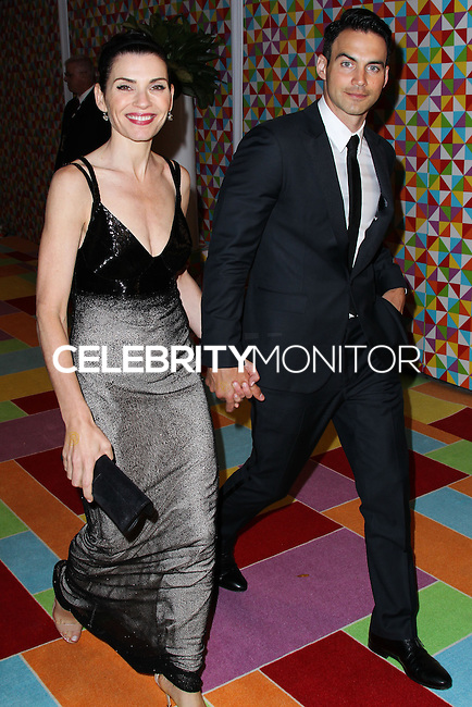 WEST HOLLYWOOD, CA, USA - AUGUST 25: Julianna Margulies, Keith Lieberthal at HBO's 66th Annual Primetime Emmy Awards After Party held at the Pacific Design Center on August 25, 2014 in West Hollywood, California, United States. (Photo by Xavier Collin/Celebrity Monitor)
