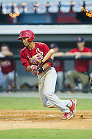 Oscar Mercado (4) of the Johnson City Cardinals follows through on his swing against the Burlington Royals at Burlington Athletic Park on July 14, 2014 in Burlington, North Carolina.  The Cardinals defeated the Royals 9-4.  (Brian Westerholt/Four Seam Images)