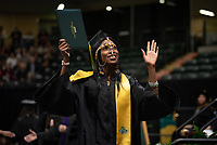 Cross country and track and field star Caroline Kurgat, B.S. Nursing, an international student from Kenya, graduates at UAA's 2019 Fall Commencement at the Alaska Airlines Center.