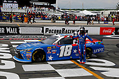 #18: Kyle Busch, Joe Gibbs Racing, Toyota Camry Comcast Salute to Service Juniper celebrates his win