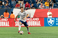 FOXBOROUGH, MA - AUGUST 18: Julian Gressel #31 of D.C. United looks to pass during a game between D.C. United and New England Revolution at Gillette Stadium on August 18, 2021 in Foxborough, Massachusetts.