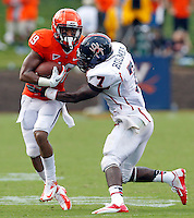 Virginia Cavaliers wide receiver E. J. Scott is tackled by Richmond Spiders defensive back DeShawn Holmes (7) during the second half of the NCAA football game Saturday September, 1, 2012 at Scott Stadium in Charlottesville, Va. Virginia defeated Richmond 43-19.