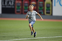 A young fan competes in a contest between innings of the game between the Wilmington Blue Rocks and the Hudson Valley Renegades at Dutchess Stadium on July 27, 2021 in Wappingers Falls, New York. (Brian Westerholt/Four Seam Images)