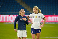 LE HAVRE, FRANCE - APRIL 13: Lindsey Horan #9 of the United States and Eugénie le Sommer #9 of France have a chat after the game during a game between France and USWNT at Stade Oceane on April 13, 2021 in Le Havre, France.