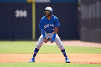 FCL Blue Jays Peniel Brito (59) leads off first base during a game against the FCL Yankees on June 29, 2021 at the Yankees Minor League Complex in Tampa, Florida.  (Mike Janes/Four Seam Images)