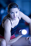 portrait of 20ish year old female trainer working out