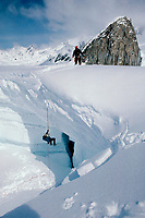 Mountaineer Climbing Out Of Crevasse a crevasse on the Ruth Glacier. CIRCA 1984