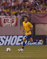 Brazil defender David Luiz (4) dribbles. Brazil  defeated the US men's national team, 2-0, in a friendly at Meadowlands Stadium on August 10, 2010.