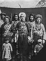 Iran 1942  In a private house of Saquez,  in front Seid Aziz Saidat, sent by his father to be the ruler in Saqez, with some of his fighters behind him. Left, Seid Faraj Hasani with Rauf Hasani in front of him, his son and right, Seid Jalal Hasani with Saleh Hasani, in front of him,  his son.  Iran 1942 Dans une maison privé a Saqez, debout au milieu, Seid Aziz Saidat, envoyé par son pere pour prendre le pouvoir a Saqez, entouré a gauche de Seid Faraj Hasani avec son fils et a droite, Seid Jalal Hasani avec son fils devant lui.