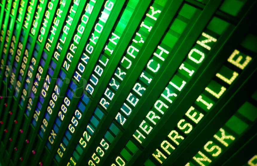 Detail close up of an international flight departure  arrival board at an airport.