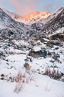 Winter sunset on Phipps Peak 1965m above Tample Basin ski field, Arthur's Pass National Park, Canterbury, South Island, New Zealand, NZ