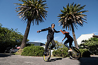Students practice using unicycles at the Cape Town College of Magic.