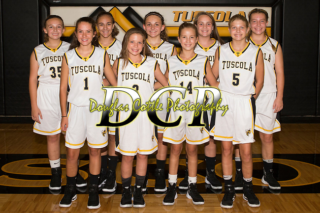 September 18, 2017- Tuscola, IL- The 2017 Tuscola Hornets 7th grade girls basketball team. Alternating from left are Brooke Thull, Hailey Downs, Natalie Veach, Ella Boyer, Claire Meyer, Reggan Smith, Marley Good, Isabelle Wilcox, and Molly Macaulay. (Not pictured: Harley Woodard) [Photo: Douglas Cottle]
