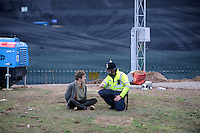 A policemen talks to a protester arrested as he entered the grounds of Ratcliffe on Soar coal fired power station, south of Nottingham. The power station, owned by E.ON, is the third largest emitter of greenhouse gases in the UK.