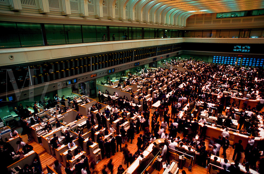 Overview of the Tokyo Stock Exchange - the interior trading floor and activity of traders. Tokyo, Nihombashi district, Japan.