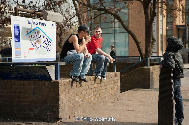 Young men talking on the Harrow Road, by Warwick Estate, West London.