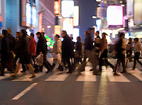 AVAILABLE FROM GETTY IMAGES FOR COMMERCIAL AND EDITORIAL LICENSING.   Please go to www.gettyimages.com and search for image # 135307805.<br /> <br /> Busy, Blurred Motion Scene of Commuters Crossing Street and Heading Home After Work During the Evening Rush Hour, Times Square and 42nd Street, Midtown Manhattan, New York City, New York State, USA