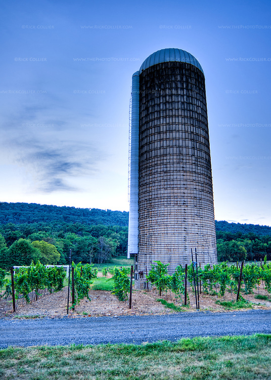 An old grain silo stands in a vineyard next to the parking area at Doukenie Winery.  (HDR Image)