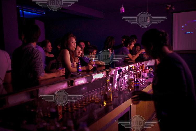 Young men and women socialising in a popular bar in Thimpu.