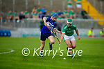 St Brendan's Daniel Finnegan and David Goulsing of  Ballyduff tussle for possession, in round 2 of the County Hurling Championship