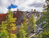 Lava butte with fire watch tower and snow.  Newberry National Volcanic Monument. Oregon.