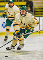 29 December 2013:  University of Vermont Catamount Defenseman Michael Paliotta, a Junior from Westport, CT, controls the puck during the first period against the Canisius College Golden Griffins at Gutterson Fieldhouse in Burlington, Vermont. The Catamounts defeated the Golden Griffins 6-2 to capture the 2013 Sheraton/TD Bank Catamount Cup NCAA Hockey Tournament for the second straight year. Mandatory Credit: Ed Wolfstein Photo *** RAW (NEF) Image File Available ***