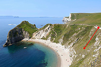 BNPS.co.uk (01202 558833)<br /> Pic: Graham Hunt/BNPS<br /> <br /> A dog had a lucky escape after it fell 65ft off a cliff at a hugely popular beauty spot.<br /> <br /> Milo the golden labrador was walking with his family at the top of the 200ft cliff at Durdle Door in Dorset on Monday afternoon when he suddenly disappeared over the edge.<br /> <br /> Thankfully the spot where he fell was a steep slope rather than a sheer drop and he managed to stop 65ft down the cliff.