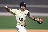 UCF Knights catcher / third baseman Chris Taladay #20 throws to first during a game against the Siena Saints at the UCF Baseball Complex on March 4, 2012 in Orlando, Florida.  Central Florida defeated Siena 15-2.  (Mike Janes/Four Seam Images)