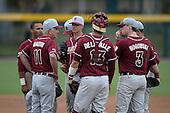 Florida State Seminoles head coach Mike Martin (11) talks with pitcher pitcher Billy Strode (5), catcher Danny De La Calle (13) and first baseman John Nogowski (3) during a game against the South Florida Bulls on March 5, 2014 at Red McEwen Field in Tampa, Florida.  Florida State defeated South Florida 4-1.  (Copyright Mike Janes Photography)