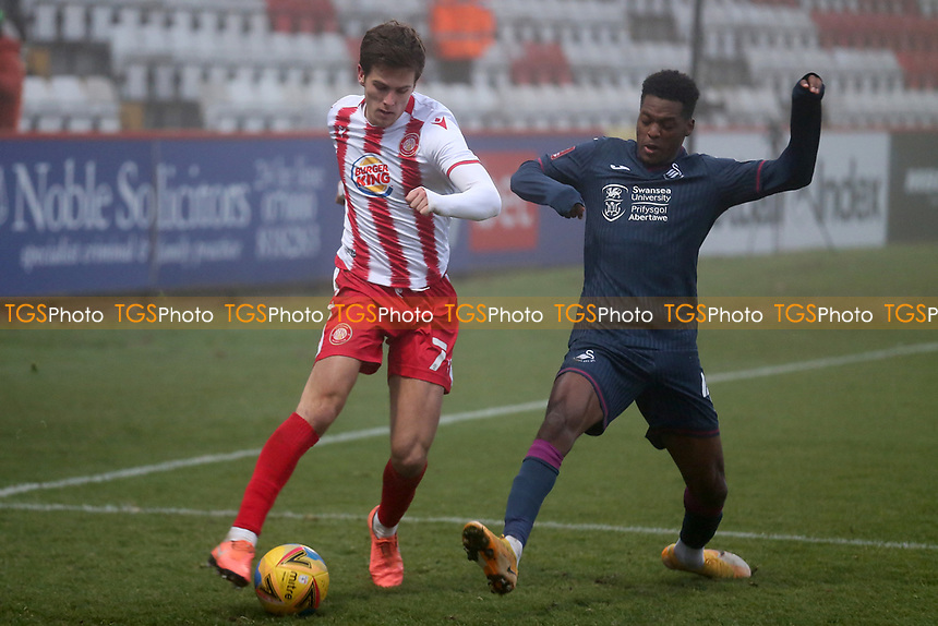Charlie Carter of Stevenage ns Jordan Garrick of Swansea City during Stevenage vs Swansea City, Emirates FA Cup Football at the Lamex Stadium on 9th January 2021