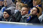 Hearts striker Ryan Stevenson watching the match at Ibrox