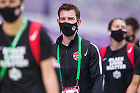ORLANDO, FL - FEBRUARY 24: CANWNT Assistant Coach walks into the stadium before a game between Brazil and Canada at Exploria Stadium on February 24, 2021 in Orlando, Florida.
