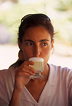 Woman drinking a Pisco Sour the national drink of Chile. South America 2000s