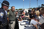 Carson City Sheriff Ken Furlong, center, and Trooper Chuck Allen, answer media questions following a shooting in an IHOP restaurant in Carson City, Nev., on Tuesday, Sept. 6, 2011. Three people were killed and six injured in the attack.  (AP Photo/Cathleen Allison)
