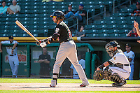 Kyle Parker (11) of the Albuquerque Isotopes at bat against the Salt Lake Bees in Pacific Coast League action at Smith's Ballpark on June 8, 2015 in Salt Lake City, Utah.   The Bees defeated the Isotopes 10-7 in game one of a double-header.(Stephen Smith/Four Seam Images)