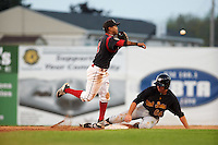 Batavia Muckdogs second baseman Giovanny Alfonzo (8) throws to first as Ryan Nagle (64) slides into second during a game against the West Virginia Black Bears on August 30, 2015 at Dwyer Stadium in Batavia, New York.  Batavia defeated West Virginia 8-5.  (Mike Janes/Four Seam Images)
