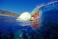 Young man body boarding on the north shore of Maui