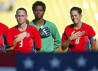 14 August 2004:   (From left to right) USA Christie Rampone, Briana Scurry, Julie Foudy during national anthem at Kaftanzoglio Stadium in Thessaloniki, Greece.   USA defeated Brazil, 2-0. Credit: Michael Pimentel / ISI