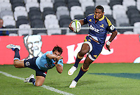 Highlanders Waisake Naholo breaks through the tackle of Waratahs Nick Phipps and heads for the try line in the Super 15 rugby match, Forsyth Barr Stadium, Dunedin, New Zealand, Saturday, March 14, 2015. Credit: SNPA/Dianne Manson